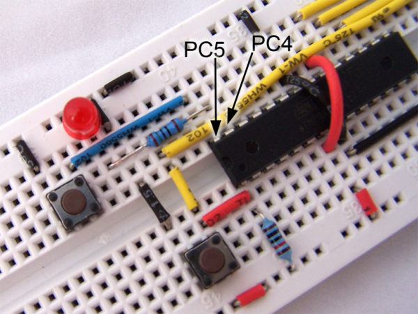 atmega8 on breadboard with switch and LED